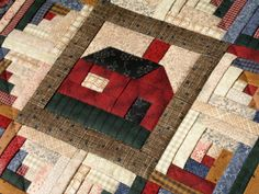 Log cabin quilt with house in center