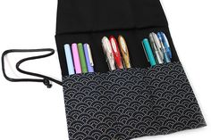 This traditional Japanese fabric patterned roll up pen case from Saki is too cute and elegant.