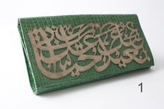 HAYATI CLUTCH    Product code:51a  PRICE: £250.00  Make a statement with Sunflowers' leather clutch, day or night, the perfect addition to your outfit. The centre piece is hand chiseled on copper with Corfi calligraphy.  The Arabic Calligraphy reads: بعيد عنك حياتي عذاب  Translates as ''Away from you, my life is torment''
