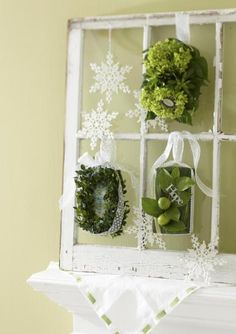 Transform your mantel into a focal point using this idea for easy Christmas decorating.  ...I have an old window frame in my barn I have been waiting for the right project to do something with it. I like the idea of tying stuff on because then it could be switched up for different occasions and seasons!
