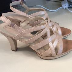 Tan colored heels Tan colored heels with side Velcro buckle. Only worn a few times Naturalizer Shoes Heels