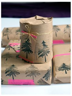 Kraft paper stamped with hunter trees + hot pink tape