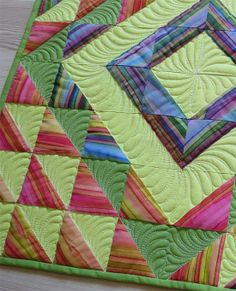 Geta's Quilting Studio: Follow Your Passion! HSTs with hand dyed stripes in barn raising layout.