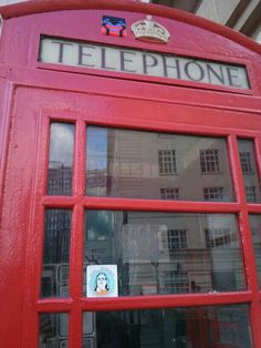 Must play the role of a typical tourist and take a photo standing next to a red phone booth!