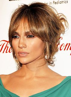 A sophisticated updo with a heavy fringe. This is a bit of a Bardot look. #jenniferlopez #jlo #hair