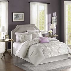 Madison Park Essentials Fulton brings luxury and beauty to any bedroom. This grey comforter is covered in elegant grey and light purple floral tree branches with subtle purple details.