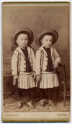 Little boys in dresses with guns. Because It was a given fact that sons were more valuable than daughters, it was supposed that Satan wanted to take boys more than he wanted girls, so, to trick the devil and protect the boys they were dressed as girls until their most vulnerable age was past.
