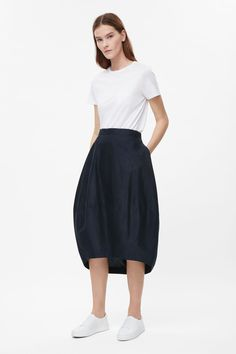 This rounded cocoon skirt is made from a blend of silk and cotton with a fine striped texture. Designed to sit on the waist, it has two in-seam pockets, hidden back zip fastening and a slightly graduated hemline. Funky Fashion, Office Fashion, Minimal Fashion, Minimal Style, Cos Skirts, Cool Outfits, Fashion Outfits, Fashion Styles, Fashion Ideas