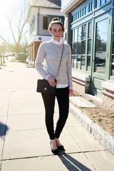 167f78b99c3 Black skinny trousers + white ruffled oxford blouse + gray pullover v-neck  sweater + black flats + black bag + ballerina bun