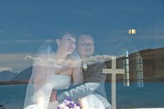 Bride and Groom inside the Church of the Good Shepherd - Wedding reflection of the lake and mountains