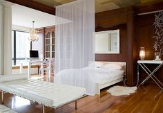 I like this room divider. I wonder how it would look all around the bed...