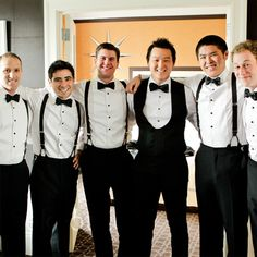 The groomsmen wore suspenders and bow ties with their black tuxedos.