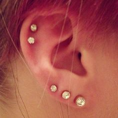 Triple earlobe and double cartilage piercing
