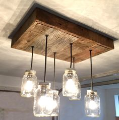 This rustic barnboard mason jar chandelier will bring character to any modern space. Made from solid, 100+ year old barnboard, this sturdy light