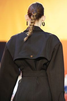OUTFIT: | Black Coat with Cape Back Detail + wear with Skinny Black Pants or Black Wide Leg Trousers + High Ponytail Braid + Thick Dark Hoop Earrings finish off and complete the Look!   |   (Céline Spring 2016 Ready-to-Wear Fashion Show Details)