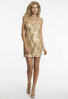 A gold goddess is what you'll be, arriving to your prom in such a glamorous dress! This short sexy number begins with an exquisite beaded illusion neckline and capped sleeve. The sweetheart neckline is simply stunning and begins this short sheath dress. With dazzling designs of sequin this look was made to be a prom dress. From behind, this short party dress is still fabulous with an almost all illusion design and open keyhole detail! Couple such a red-carpet worthy design like this with a…