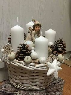 Little Angel With Candles in A Basket And Dried Pinecones Christmas Decoration