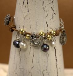 Fearless Leather Bracelet  has a mermaid charm on it....love this!!