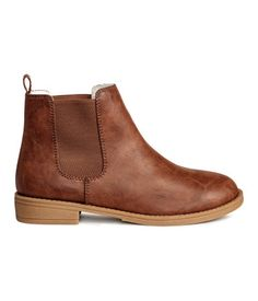 Brown. Chelsea boots with elasticized panels at sides and rubber soles.