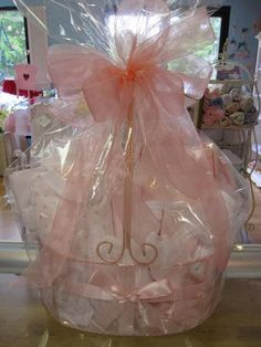 clear gift bag and pink netting around that Baby Shower Gift Basket, Baby Shower Gifts, Baby Gifts, Basket Gift, Wrapping Gift Baskets, Gift Wraping, Clear Gift Bags, Christmas Baby Shower, Wraps