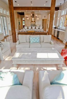 House of Turquoise: WaterColor Beach Home love the beams dividing the rooms