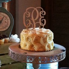 This delicate laser cut monogram cake topper is a beautiful addition to your wedding cake!