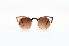 Óculos cat eye dourado lente degradê