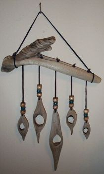 Driftwood wall hanging/mobile - drill holes and set sea glass inside.