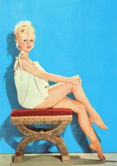 Brigitte Bardot. French postcard by Editions P.I., Paris, no. 1036. Photo: Sam Lévin.