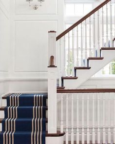 Staircase runners soften the look of a staircase and add colour and texture. Image source: Pinterest