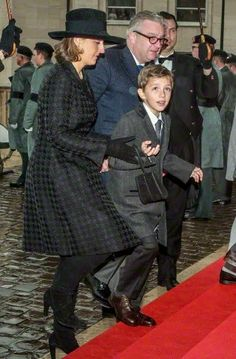 12.12.2014 - Belgium's Princess Claire, Prince Laurent & 1 of their twin sons, Prince Aymeric, attend the funeral of Queen Fabiola at Notre Dame Church in Laeken, Belgium.
