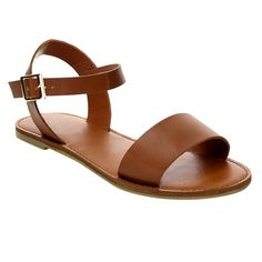 Flat tan sandal featuring an adjustable ankle strap with buckle closure. Minimal and ultra comfortable. Vegan, man made leather.