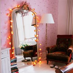 oversized mirror+amber lights+tapestry chair+pink walls~