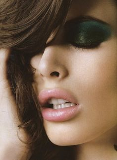 Pale pink lips and heavy deep green smokey eye.
