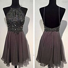 Description:  Silhouette:+A-line Neckline:+High+Neck Hemline/Train:Short/Mini Sleeve+Length:Sleeveless Embellishment:Appliques,Rhinestone Back+Details:Backless Fabric:Taffeta