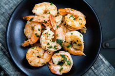 Quick and easy shrimp scampi, shrimp sautéed with garlic in butter, olive oil, and white wine, tossed with red pepper flakes and parsley.