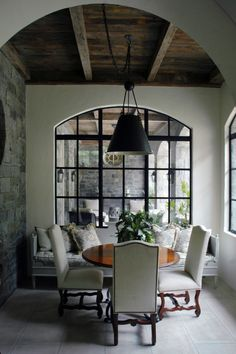 Pretty Room and love the rock wall...  Elegant details in a breakfast room by William B. Litchfield.