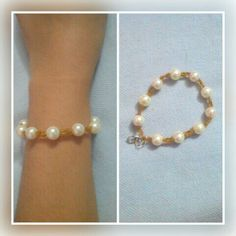 White moti with golden seed bead bracelet. Price - Rs 120/-