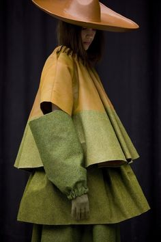Garment in Landscape by Satu Maraanen. She has covered silk, cotton and viscose with grass, sawdust and sand.