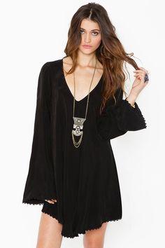 I adore short black long sleeved dress