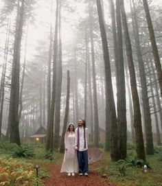 Nikita Gearing and John Coughenour walk through the forest to their wedding at WildSpring Guest Habitat.