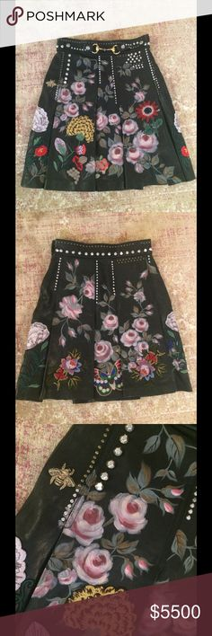 Gucci hand painted and embroidered leather skirt Pleated leather skirt with a horsebit buckle. Enhanced with hand painted flowers, embroideries and stud details. Silk crepe de chine lining. Made in Italy. IT Size 40. Gucci Skirts A-Line or Full