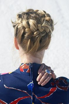 Crown braids, my oldest sister would do my hair like this when I was little. Wow that must have taken a TON of patience.