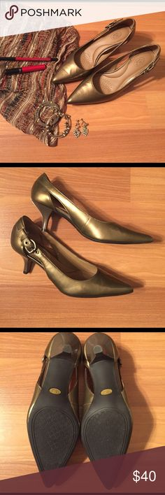Circa Joan & David Calla Lily Patent Leather Pumps Like new. Brand: Circa Joan and David. Style: Calla Lily. These pumps are a phenomenal shoe. Great color and style make them a shoe for all occasions. Metallic gold in color. Patent leather is in perfect condition. Never worn so no actual wear on the soles. Small spot on inside of shoe near heel - smaller than a quarter in length and maybe a centimeter tall. Please let me know if you'd like an extra pic. Accessories not included. Please let…