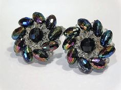 ITEM # 101633  Vintage mid century rhinestone aurora borealis earrings signed Western Germany. These clip ons measure approx 1 1/4 in diameter. Tubular honeycomb faceted rhinestones have an aurora borealis finish.  Good vintage condition with typical wear due to age and handling. Wear to the aurora borealis finish as seen in photos.  Please visit my other Etsy shop for antique & vintage porcelain at https://www.etsy.com/shop/PattysPorcelainEtc  PLEASE let me know if you need any additional…