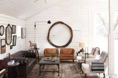 Love the white chairs!  Get the Look: Ellen & Portias Art Barn | Apartment Therapy