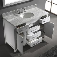 Give your bathroom an instant update with this modern bathroom vanity set that features lots of space for storing bathroom essentials. Open the roomy drawers of this modern bathroom vanity set to reve