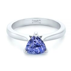 This elegant engagement ring features a trillion cut purple sapphire in a three prong setting. Designed and created by Joseph Jewelry Elegant Engagement Rings, Alternative Engagement Rings, Perfect Engagement Ring, Unique Rings, Beautiful Rings, Joseph, Seattle, Purple Sapphire, Diamond Solitaire Rings