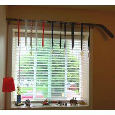 Idea for sports medals! Hockey stick medal hanger.