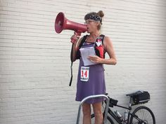 Kathy Hoover gives some pre-race announcements. Look both ways before crossing the streets, be nice to each other and to the Quik Trip people